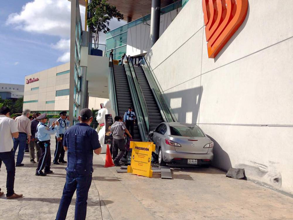 """Pic shows: Mazda next to the shopping mall escalator.nnA Mexican teen who hit the headlines by driving her car up the steps of an escalator has received an early Christmas gift.nnA group of anonymous internet users crowd-funded together to pay for a lawyer for her and to cover some of the costs of her wrecking spree.nnYumaira Lara, 18, was driving a borrowed Mazda car through the parking lot of a shopping mall in her town of Merida in Mexico when she hit the exterior escalators of the complex.nn One person was hurt and the car and escalators damaged. The cause of the crash remains unclear.nnThree people filed complaints to police about her. They were Eduardo Alejandro Lopez Novelo, a representative of the Altabrisa shopping mall, Ivan Centeno Moo, the injured employee, and Karina Isabel Rodriguez Aguiar, the owner of the Mazda car.nnThe escalator repair costs were estimated at nearly 80,000 GBP.nnSome internet users claimed she was trying to put the vehicle on to the Escalagtor to climb upwards.nnOnline trolls even made a photoshopped picture with visuals of the famous computer game Grand Theft Auto as if the teen had been caught by police in the game.nnBut it is no laughing matter as the teenager could be jailed for up to four years.nnYet she is grateful for the support she has received through the forum called fondeadora.mxnnAnonymous initiators of the campaign said: """"We want to help the person whose misfortune made the whole town of Merida laugh for one day on WhatsApp and social networks. Today she faces problems that are not so funny""""nnOmar Burgos, her father, said: """"My daughter drove a car that was not hers and, because she did maneuvers in a small space and does not have good driving experience, she hit some nearby escalators. This created serious damage that is impossible for me to pay.nn""""I¿d like to thank everyone who worked together with my family. We are desperate to solve this situation that my daughter faces""""nnBut she will need a lot more than the 406 U"""