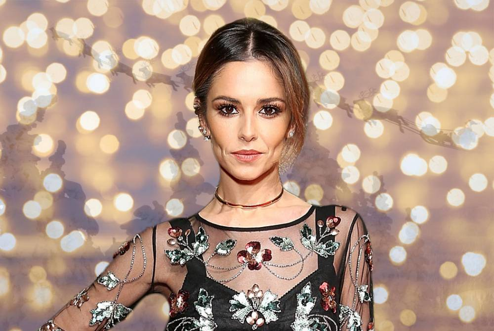 AC_CSQ_Cheryl_Comp2.jpg Guess the celebrity under the santa face Credit: Getty