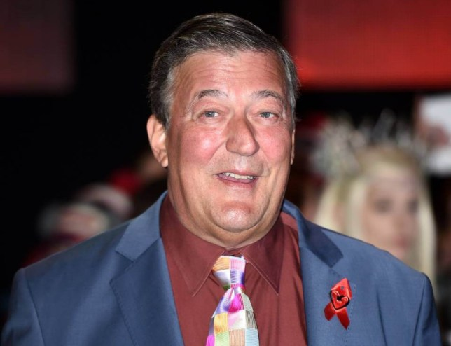 """English actor Stephen Fry poses for pictures on the red carpet upon arrival for the world premier of """"The Hobbit: The Battle of the Five Armies"""" in central London on December 1, 2014. AFP PHOTO/LEON NEAL (Photo credit should read LEON NEAL/AFP/Getty Images)"""