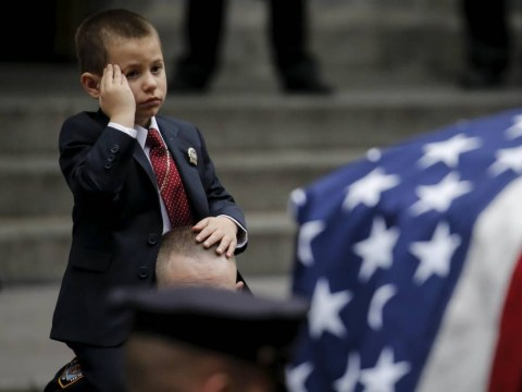 Boy salutes his father who was killed in Afghanistan