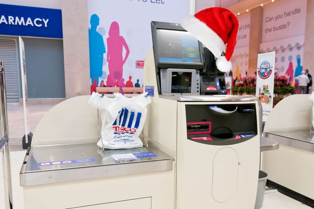 People are not okay with Tesco self-service checkout wishing them a Merry Christmas Alamy