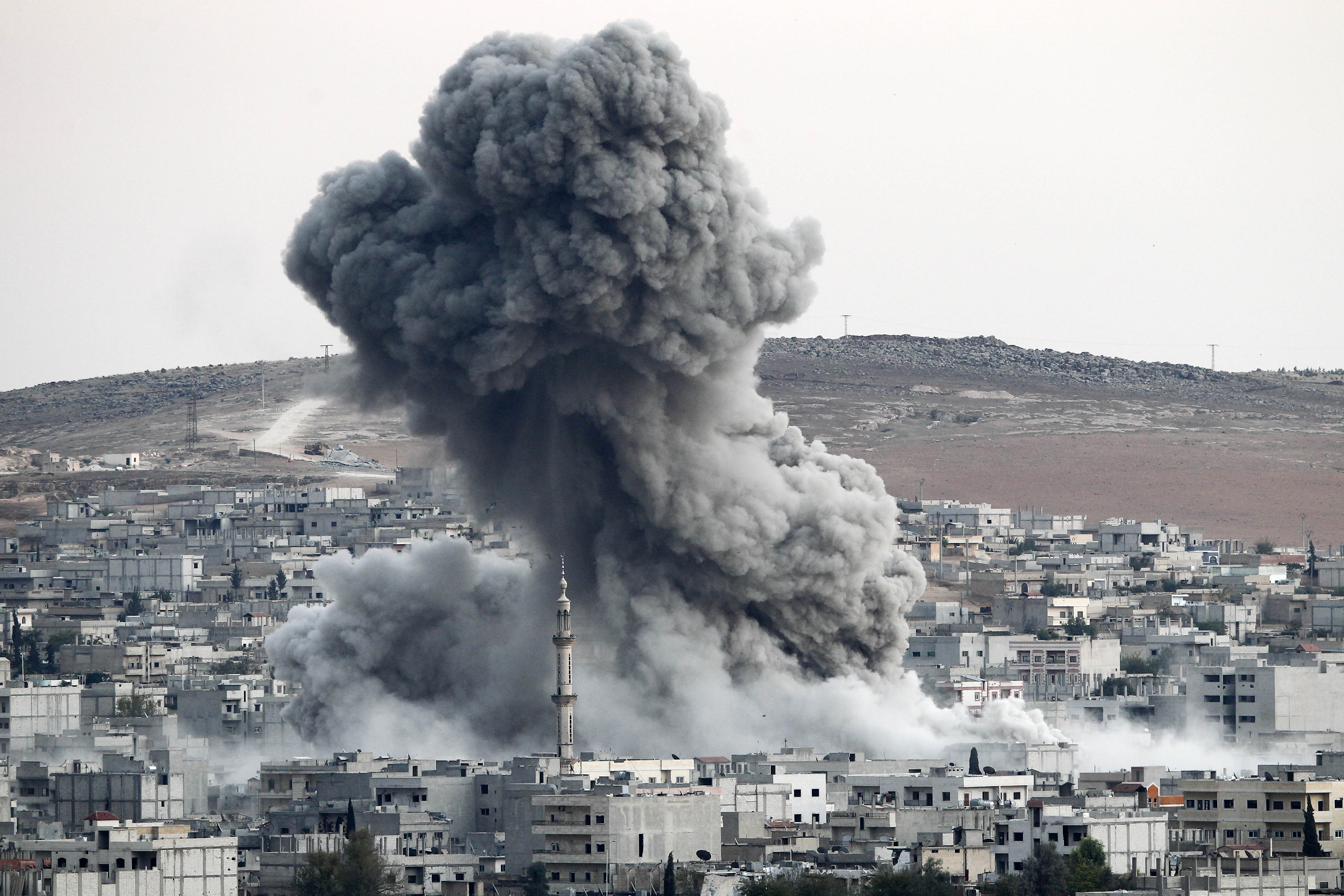 US airstrikes on the Syrian border town of Kobani (Picture: Getty Images)