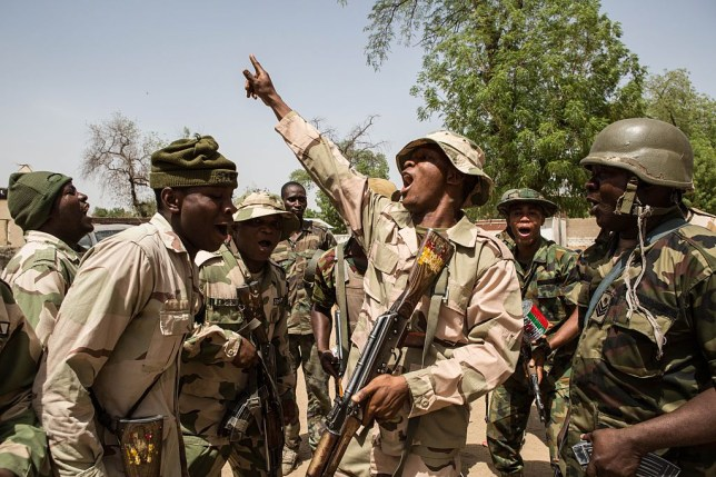 File photo of Nigerian troops after taking over Bama from Boko Haram on March 25, 2015 (Picture: AFP/Getty Images)