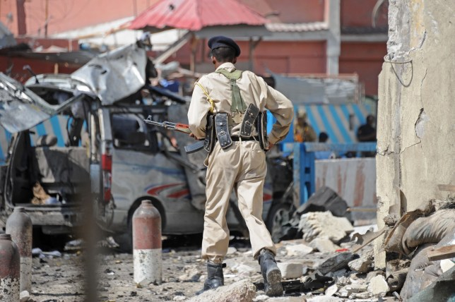 A soldier patrol the site of an explosion on November 1, 2015 near the damaged Sahafi hotel in Mogadishu. At least 12 people were killed in the Somali capital on November 1 after Shebab gunmen used a vehicle packed with explosives to blast their way inside a hotel, police said. The Al-Qaeda linked Shebab claimed responsibility for the dawn attack at the Sahafi hotel, which is popular with members of parliament, government employees and businessmen. AFP PHOTO / MOHAMED ABDIWAHAB (Photo credit should read MOHAMED ABDIWAHAB/AFP/Getty Images)