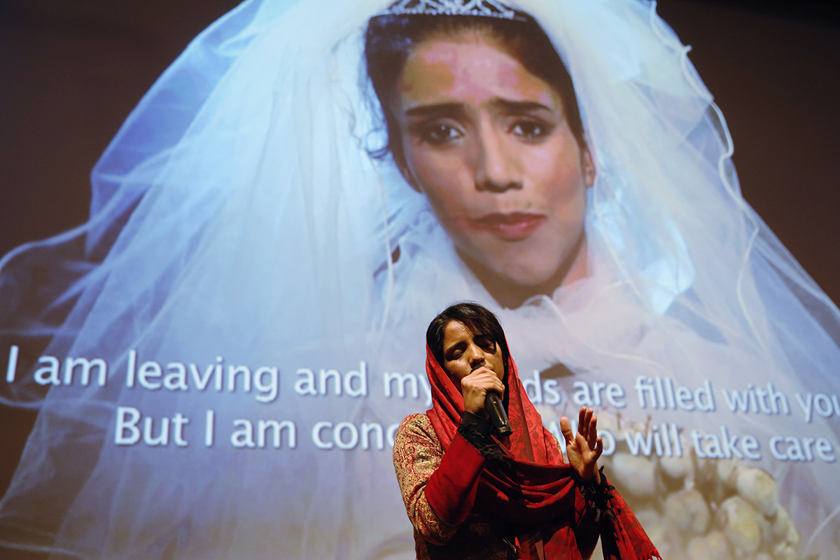 Afghan refugee and rapper Sonita Alizadeh raps after the screening of the documentary film 'Sonita' at the International Documentary Filmfestival Amsterdam (IDFA), in Amsterdam, on November 23, 2015. The documentary tells the story of Sonita Alizadeh, 19, who was just ten-years-old when her Muslim parents first attempted to sell her into marriage and who is now an activist against forced marriages. AFP PHOTO / ANP/ BAS CZERWINSKI =NETHERLANDS OUT= / AFP / BAS CZERWINSKI (Photo credit should read BAS CZERWINSKI/AFP/Getty Images)