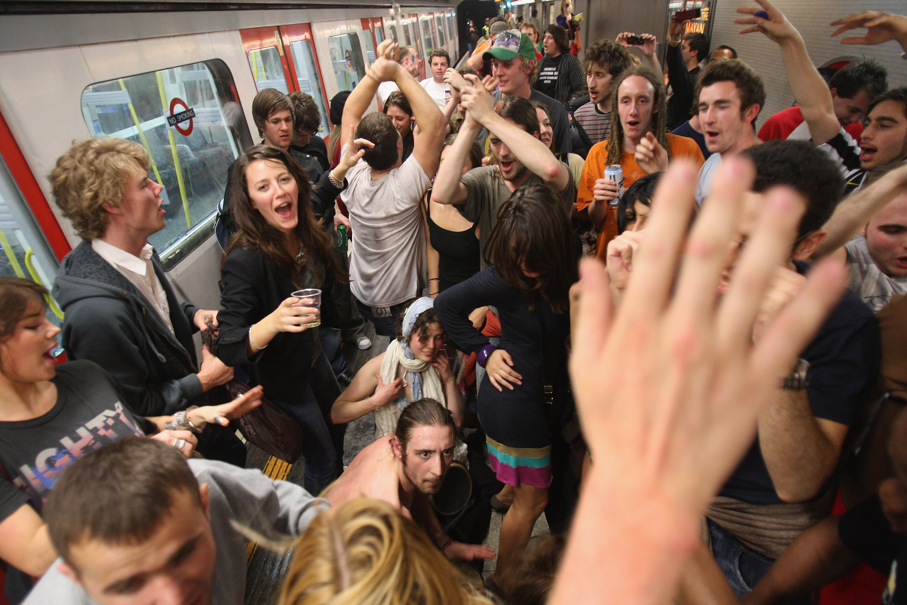 LONDON - MAY 31: Party revellers enjoy the atmosphere on the London Underground at King's Cross Station during a Facebook cocktail party on the Circle Line on May 31, 2008 in central London, England. Tonight is the last evening when Londoners can consume alcohol on public transport. The cocktail party, organised on the networking Web site Facebook, attracted thousands of revellers to enjoy one last drink on the London Underground before the ban's enforcement on June 1, 2008. The ban, introduced by the new London Mayor Boris Johnson, is an attempt to clean up unruly behaviour on the London public transport system. (Photo by Daniel Berehulak/Getty Images)