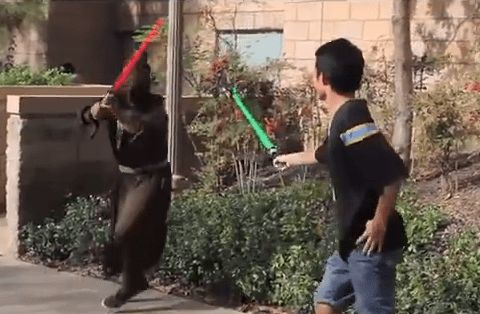 Man starts lightsaber duels with random strangers and the results are fantastic