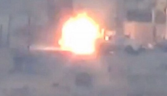 Video shows Hezbollah fighter's car in Syria narrowly avoiding