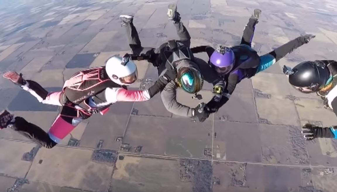 Daredevil tattoos 'AHHH' on a woman's wrist… while they're both skydiving
