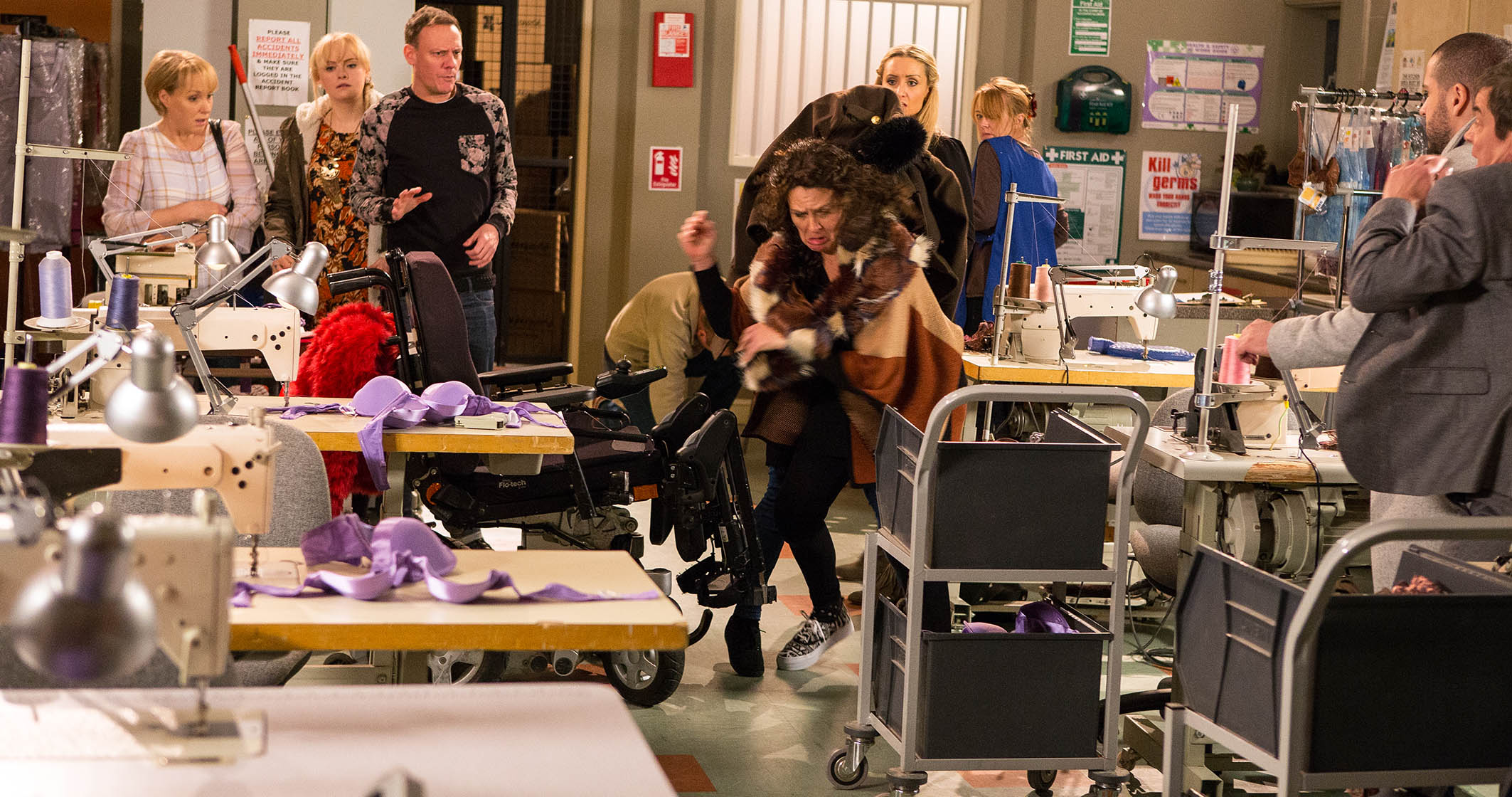 FROM ITV STRICT EMBARGO - No Use Before Tuesday 2 February 2016 Coronation Street - Ep 8834 Monday 8 February 2015 - 1st Ep Eva Price [CATHERINE TYLDESLEY] heads into work early with some food for Marta [EDYTA BUDNIK]. Marta complains that she's cold and Eva promises to try and find her a coat. In the factory Sean shows off his new coat. However Sean Tully [ANTONY COTTON] is later furious to discover his coat missing. As the factory girls argue about who could have stolen it, Marta suddenly emerges from behind some boxes wearing Sean's coat and makes a dash for it. Everyone watches open mouthed. Picture contact: david.crook@itv.com on 0161 952 6214 Photographer - Mark Bruce This photograph is (C) ITV Plc and can only be reproduced for editorial purposes directly in connection with the programme or event mentioned above, or ITV plc. Once made available by ITV plc Picture Desk, this photograph can be reproduced once only up until the transmission [TX] date and no reproduction fee will be charged. Any subsequent usage may incur a fee. This photograph must not be manipulated [excluding basic cropping] in a manner which alters the visual appearance of the person photographed deemed detrimental or inappropriate by ITV plc Picture Desk. This photograph must not be syndicated to any other company, publication or website, or permanently archived, without the express written permission of ITV Plc Picture Desk. Full Terms and conditions are available on the website www.itvpictures.com