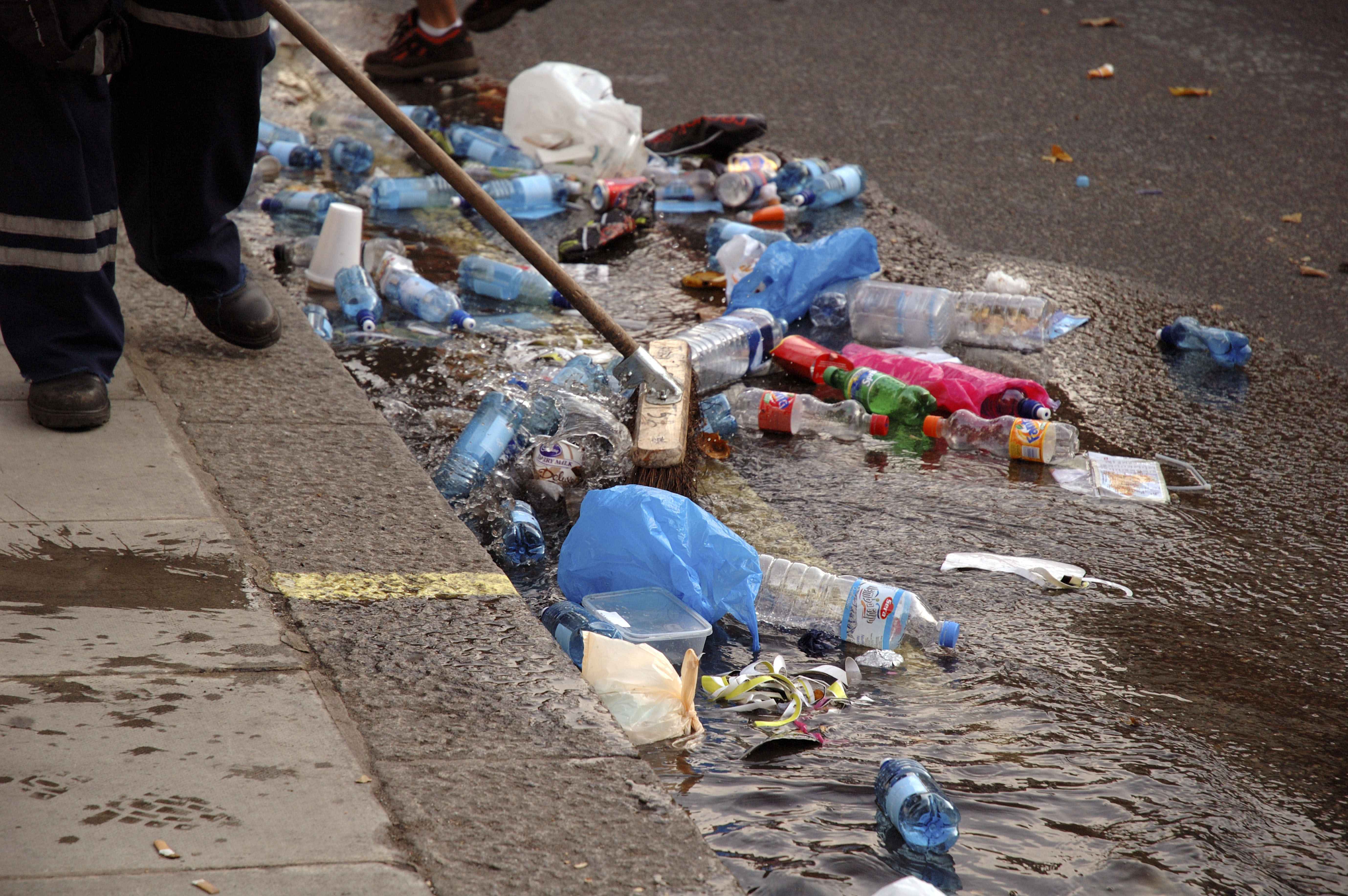 Street cleaners in central London clearing debris (Picture: Getty Images)