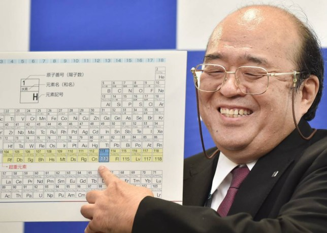 Kosuke Morita, the leader of the Riken team, smiles as he points to a board displaying the new atomic element 113 during a press conference in Wako, Saitama prefecture on December 31, 2015. A Japanese research team has received naming rights for new atomic element 113, the first on the periodic chart to be named by Asian scientists, the team's institute said December 31. Japan's Riken Institute said a team led by Kosuke Morita was awarded the rights from global scientific bodies -- the International Union of Pure and Applied Chemistry (IUPAC) and the International Union of Pure and Applied Physics (IUPAP) -- after successfully creating the new synthetic element three times from 2004 to 2012. AFP PHOTO / KAZUHIRO NOGIKAZUHIRO NOGI/AFP/Getty Images