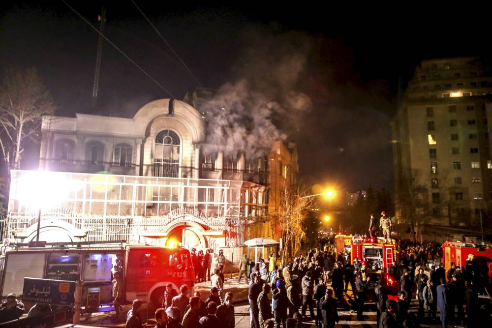 Flames rise from Saudi Arabia's embassy during a demonstration in Tehran January 2, 2016. Iranian protesters stormed the Saudi Embassy in Tehran early on Sunday morning as Shi'ite Muslim Iran reacted with fury to Saudi Arabia's execution of a prominent Shi'ite cleric. REUTERS/TIMA/Mehdi Ghasemi/ISNA ATTENTION EDITORS - THIS PICTURE WAS PROVIDED BY A THIRD PARTY. REUTERS IS UNABLE TO INDEPENDENTLY VERIFY THE AUTHENTICITY, CONTENT, LOCATION OR DATE OF THIS IMAGE. FOR EDITORIAL USE ONLY. NOT FOR SALE FOR MARKETING OR ADVERTISING CAMPAIGNS. NO THIRD PARTY SALES. NOT FOR USE BY REUTERS THIRD PARTY DISTRIBUTORS. THIS PICTURE IS DISTRIBUTED EXACTLY AS RECEIVED BY REUTERS, AS A SERVICE TO CLIENTS      TPX IMAGES OF THE DAY