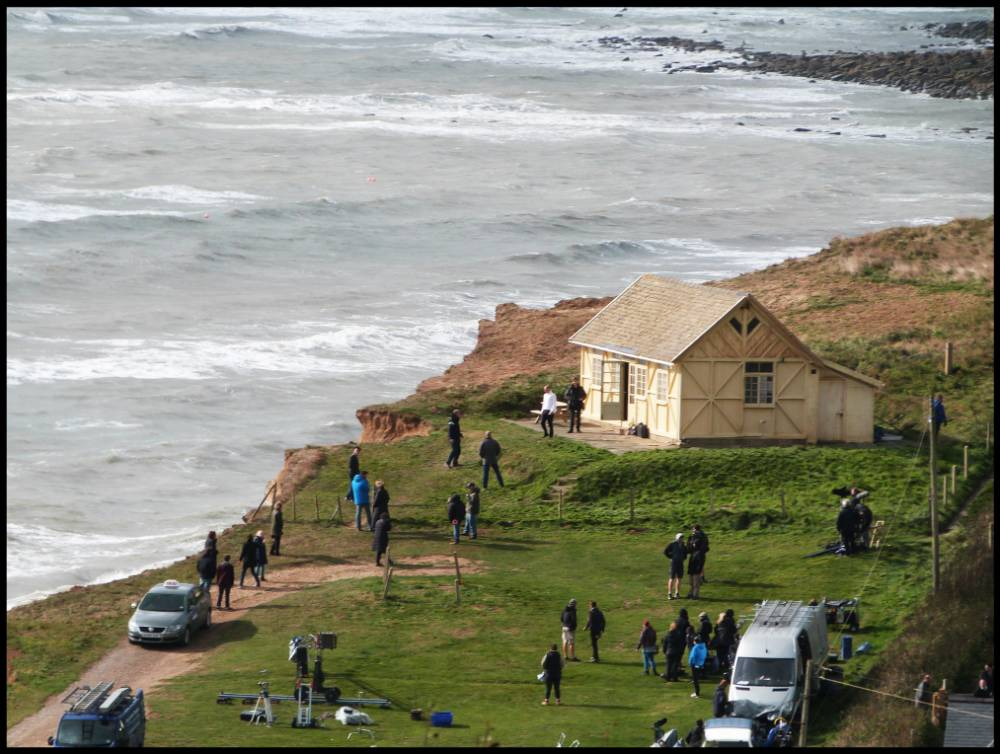 BNPS.co.uk (01202 558833) Pic: JamesLoveridge/BNPS ***Please Use Full Byline*** Crime drama to soap opera The filming of the new series of Broadchurch could be thrown into chaos as one of the key locations for the ITV crime drama is set to be demolished. The wooden chalet perched on top of the cliffs of the fictional seaside town was the murder scene in the first series of Broadchurch and was featured prominently in the second. But the owners of the hut want to demolish it as it is in danger of falling into the sea due to coastal erosion.