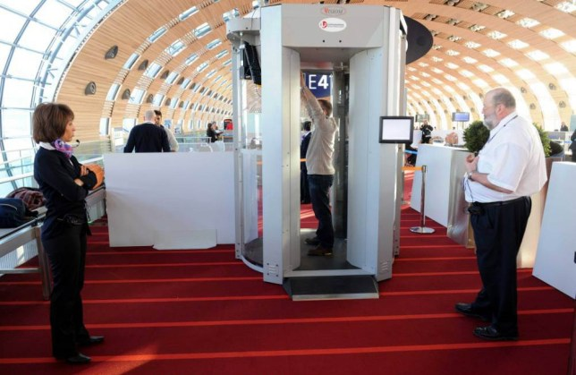 Mandatory Credit: Photo by Sipa Press/REX/Shutterstock (1122686a).. Full body scanner in use at Charles de Gaulle airport.. Full body scanner introduced at Charles de Gaule airport, Paris, France - 22 Feb 2010.. Body scanner introduced for experimentation at Paris Charles de Gaulle International Airport in Roissy, before departing to the United States. The controversial scanner is capable of peering through clothes to create three-dimensional images of passengers to reveal any concealed weapons or explosives...