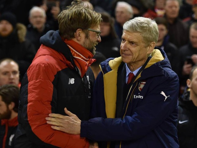 LIVERPOOL, ENGLAND - JANUARY 13: (THE SUN OUT, THE SUN ON SUNDAY OUT) Jurgen Klopp manager of Liverpool and Arsene Wenger manager of Arsenal shake hands before the Barclays Premier League match between Liverpool and Arsenal at Anfield on January 13, 2016 in Liverpool, England. (Photo by John Powell/Liverpool FC via Getty Images)
