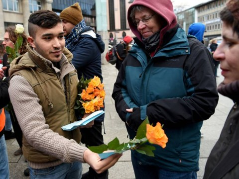 'No to Sexism, No to Racism': Syrian refugees hand out flowers in German protest