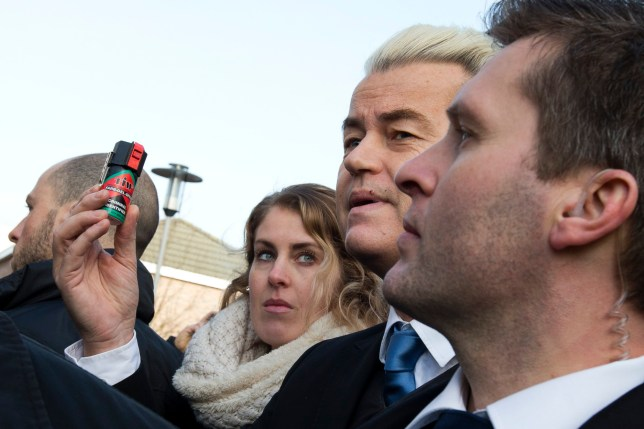 """Firebrand Dutch lawmaker Geert Wilders holds a can of pepper spray prior to handing out """"self-defense sprays"""" to women fearful of being attacked by migrants in the wake of the New Year's Eve sexual assaults in Cologne, in the center of Spijkenisse, near Rotterdam, Netherlands, Saturday, Jan. 23, 2016. Saturdayís event was a trademark headline-grabbing foray into the Dutch public by the leader of the Freedom Party. Such publicity stunts have landed him atop Dutch opinion polls a year away from parliamentary elections in the Netherlands. (AP Photo/Peter Dejong)"""