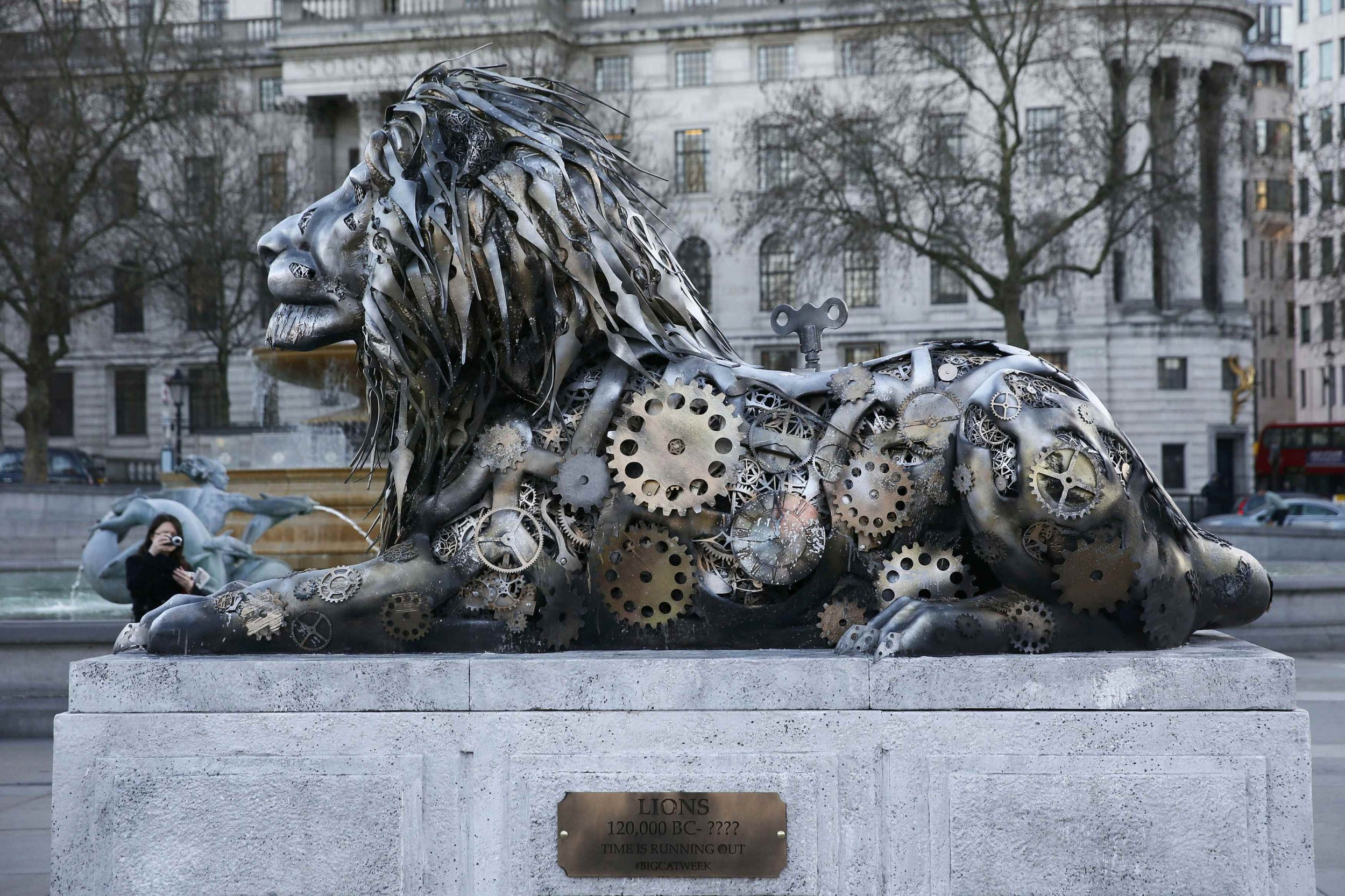 A pedestrian photographs a lion sculpture installed by National Geographic Wild to highlight the threat to endangered big cats, in Trafalgar Square in London, Britain January 28, 2016. National Geographic installed the sculpture alongside Trafalgar Square's famous lion statues to promote it's week of programming on big cats. REUTERS/Stefan Wermuth EDITORIAL USE ONLY. NO RESALES. NO ARCHIVE