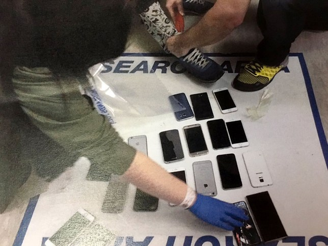 Undated handout photo issued by West Midlands Police of a number of mobile phones from 38 in total that were found stuffed down a suspected thiefs trousers at a concert by rock band The Libertines. PRESS ASSOCIATION Photo. Issue date: Thursday January 28, 2016. Police arrested the man at Birmingham's Barclaycard Arena on Wednesday night and are appealing for gig-goers who had mobiles stolen to contact officers. See PA story POLICE Trousers. Photo credit should read: West Midlands Police/PA Wire NOTE TO EDITORS: This handout photo may only be used in for editorial reporting purposes for the contemporaneous illustration of events, things or the people in the image or facts mentioned in the caption. Reuse of the picture may require further permission from the copyright holder.
