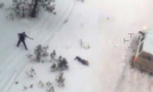 Aerial video released by the FBI January 28, 2016 shows a law enforcement officer (L) pointing a weapon at a man on the ground had just stepped out of the white pickup truck at a police roadblock January 26 near Burns, Oregon. The FBI released video showing one of the men occupying an Oregon wildlife refuge reach for his jacket pocket before he was shot dead by law enforcement after speeding away from a traffic stop where the group's leader was arrested. Authorities said 54-year-old Robert LaVoy Finicum, a rancher from Arizona who acted as a spokesman for the occupiers at the Malheur National Wildlife Refuge, was armed when he was stopped by police and killed on Tuesday afternoon. REUTERS/FBI/Handout via Reuters FOR EDITORIAL USE ONLY. NOT FOR SALE FOR MARKETING OR ADVERTISING CAMPAIGNS TPX IMAGES OF THE DAY