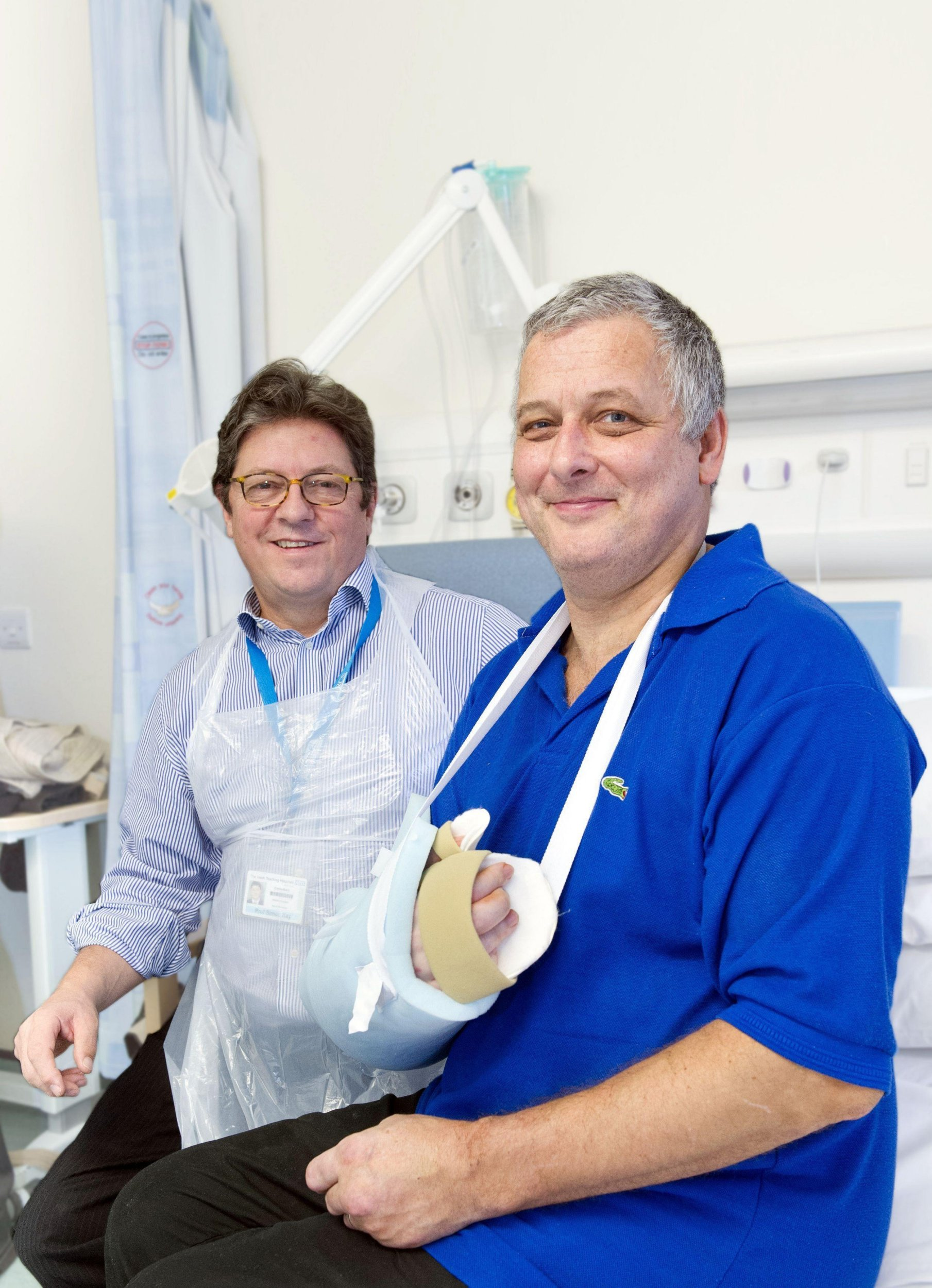 Undated handout file photo issued by Leeds General Infirmary of Professor Simon Kay (left) who operated on Mark Cahill when he became the first person in the UK to have a hand transplant, as the NHS is to fund the operation for patients in desperate need following injury or serious infection. PRESS ASSOCIATION Photo. Issue date: Friday January 29, 2016. A team in Leeds has been given the go-ahead to run the NHS programme and recruit patients who have suffered injury, an accident or sepsis. See PA story HEALTH Hands. Photo credit should read: Leeds General Infirmary/PA Wire NOTE TO EDITORS: This handout photo may only be used in for editorial reporting purposes for the contemporaneous illustration of events, things or the people in the image or facts mentioned in the caption. Reuse of the picture may require further permission from the copyright holder.