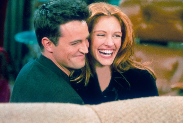 "304422 21: Actor Matthew Perry and actress Julia Roberts hug each other on the set of ""Friends."" (Photo by Liaison)"