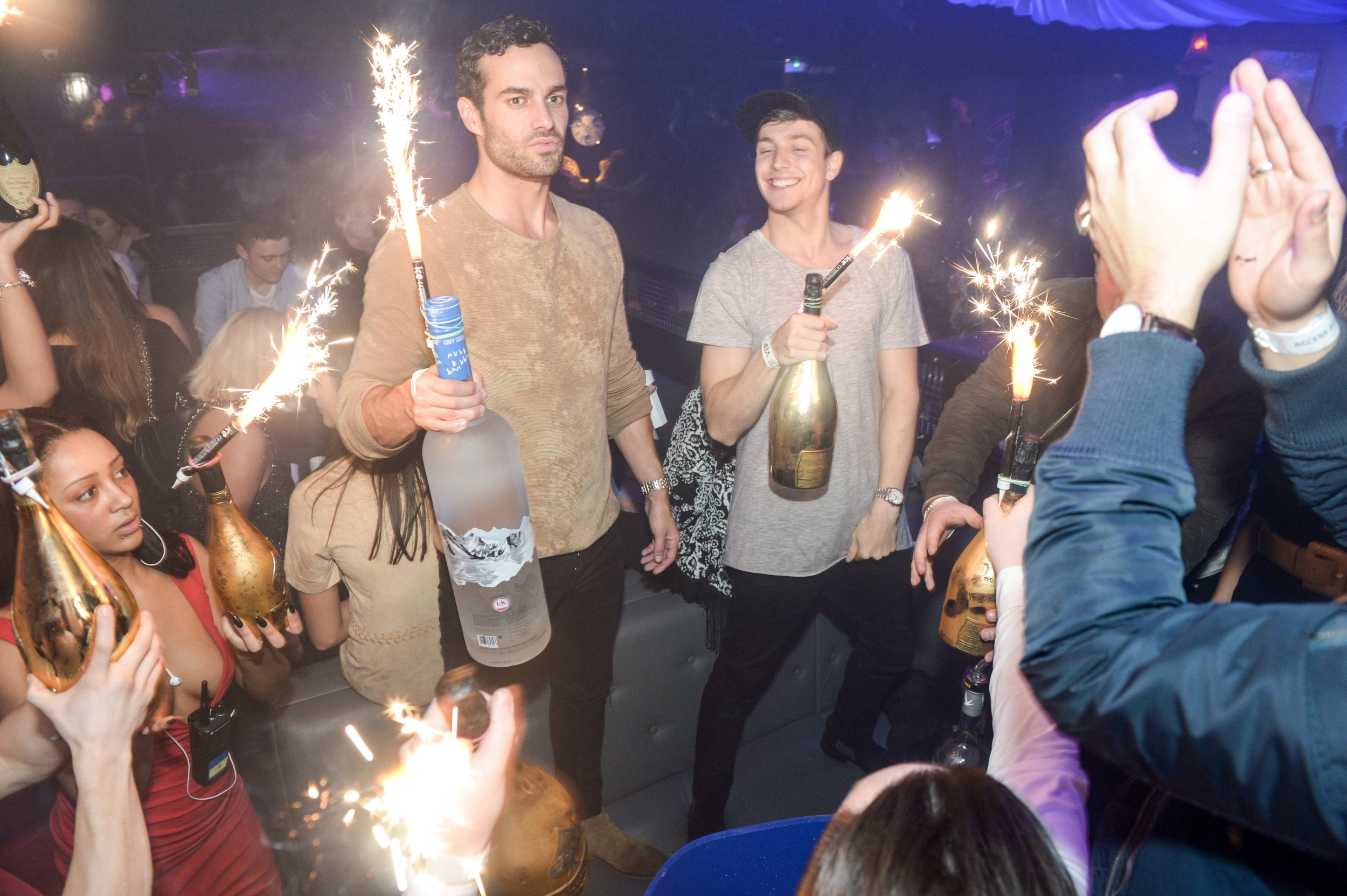 Large bottles of vodka and champagne being brought to the table at Hydeout Nightclub on its official launch night, Watford. See SWNS story SWCHELSEA; Made in Chelsea star Sam Thompson found himself hit by the bar on a wild night at the launch of a new superclub - with a £24,000 drinks tab. The reality TV hunk and a posse of co-stars downed Dom Perignon, Patron tequila, magnums of Grey Goose vodka and trendy champagne Ace of Spades. But Sam suddenly found his mates had deserted him when he was presented with the #24,320 bill at the Hydeout in Watford in the early hours of yesterday (Sat) morning. He posted a pic of the mega bill to his 186,000 Instagram followers and 100,000 Twitter followers before quickly deleting it. But his party - including Georgia Toffolo, Chase Hunter, Josh 'JP' Patterson and James Dunmore from Made in Chelsea and Ex on the Beach babe Jess Impiazzi - certainly got their money's worth for their big night out.