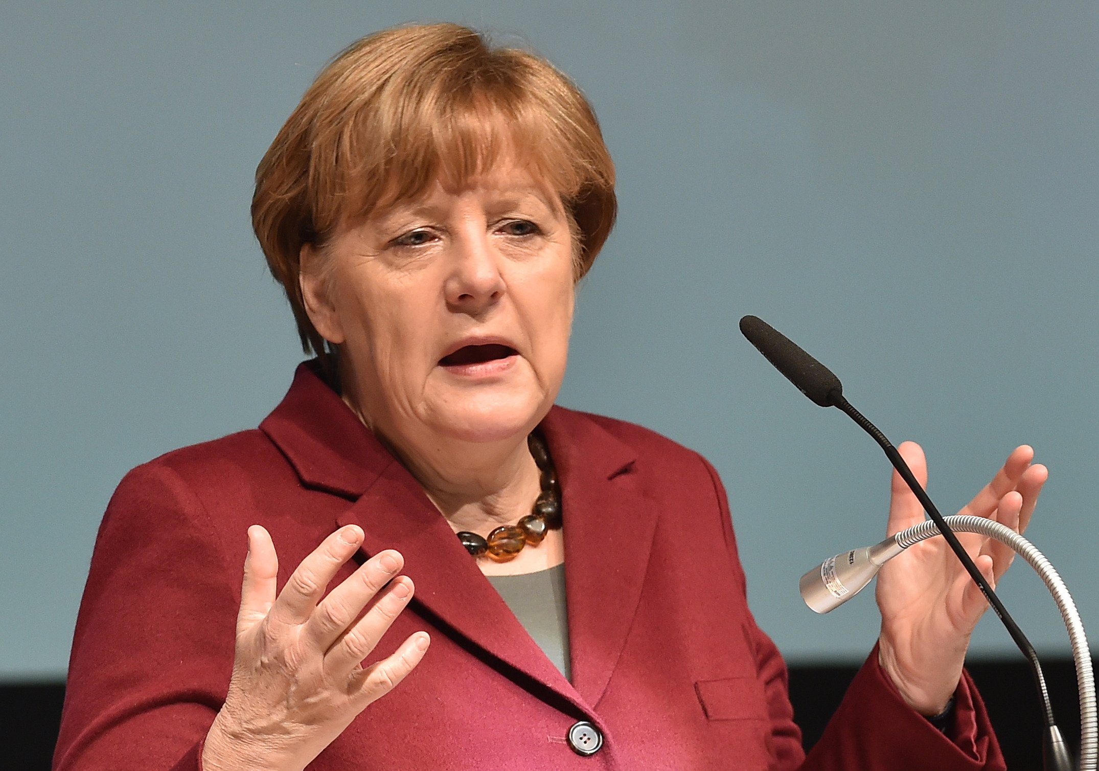 German Chancellor Angela Merkel gives a speech during a regional meeting of her Christian Democratic Union (CDU) party on January 30, 2016 in Neubrandenburg, northeastern Germany. Merkel said she expected most of the refugees from Syria and Iraq to return home once peace has returned to their countries, as she faces strong pressure over her welcoming stance towards asylum seekers. / AFP / dpa / Bernd Settnik / Germany OUTBERND SETTNIK/AFP/Getty Images
