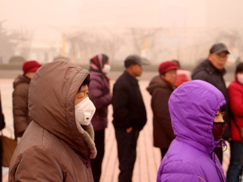 These people queued for three hours in freezing deadly smog for a free calendar