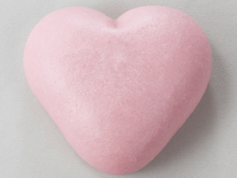 These romantic heart-shaped sweets turn into pooping butts when you microwave them