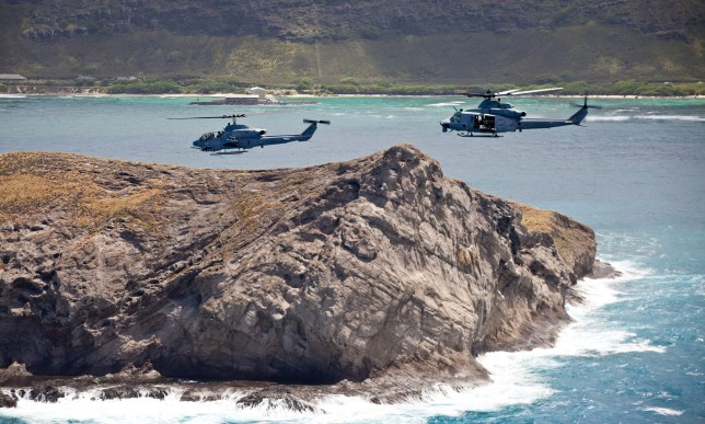DA3304 US Marine Corps UH-1W Super cobra and a UH-1Y Venom with Marine Light Attack Helicopter Squadron fly June 14, 2013 over Oahu, Hawaii.