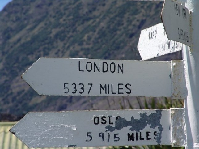 Signpost on the island of Tristan da Cunha, showing the distance to London, England. AS 999 calls go, it was a pretty long distance effort. But then, when you live in the most remote place in the world, getting help is never easy. Tristan da Cunha (population: 275), lies in the South Atlantic, 2,173km (1,359miles) from its nearest neighbour, Saint Helena. With no runway, the British overseas territoryÕs only physical link to the outside world is a monthly boat that takes a week to travel 2,800km (1,740miles) from Cape Town in South Africa with the mail. So, when its only doctor issued an urgent appeal for medical supplies, there was no time to lose. The GP wanted medicine for asthma, a message soon passed on from the South African Marine Rescue Coordination Centre to coastguards in Plymouth. The RAF was then contacted at the Air Rescue Coordination Centre at Kinloss, in Scotland. The British rescue services are now urgently trying to find ships or aircraft to deliver the medicine.