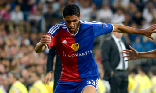 MADRID, SPAIN - SEPTEMBER 16: James Rodriguez (10) of Real Madrid vies for the ball with Mohamed Elneny (33) of FC Basel during the UEFA Champions League Group B soccer match between Real Madrid and FC Basel at Santiago Bernabeu stadium in Madrid, Spain, on September 16, 2014. (Photo by Evrim Aydin/Anadolu Agency/Getty Images)