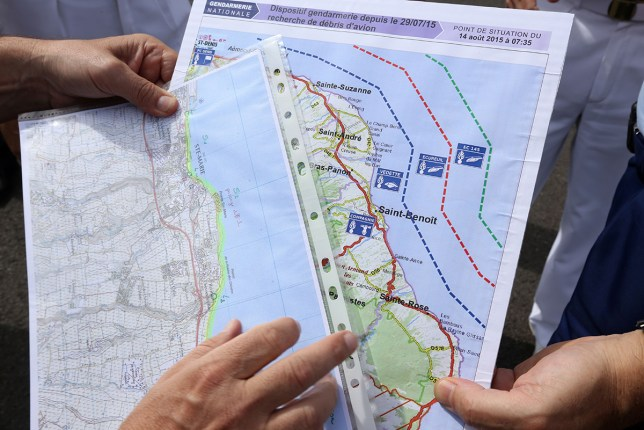 French maritime gendarmes look at a map indicating measures being undertaken in the search for wreckage from the missing MH370 plane at the marina of Saint-Marie on the French island of La Reunion (AFP Getty)