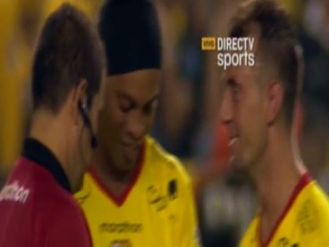 Referee asks Ronaldinho for his autograph in the middle of a match