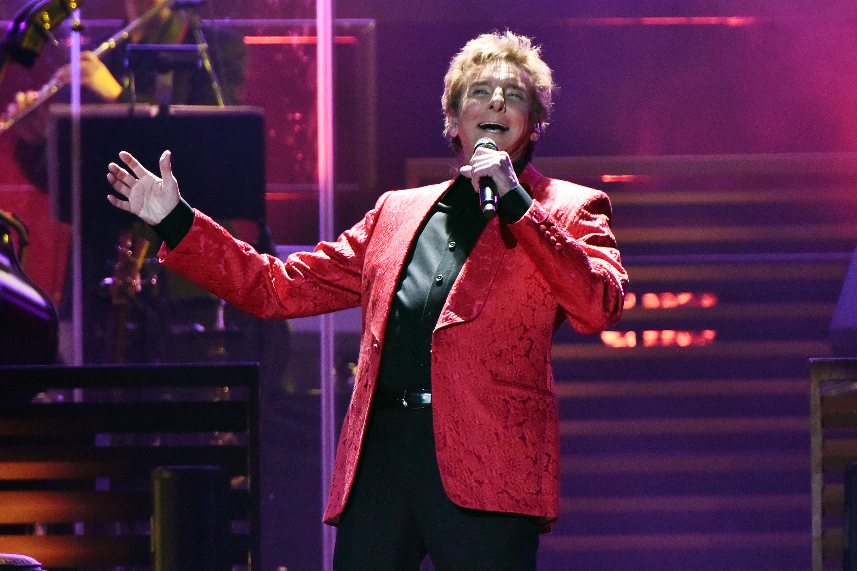 Barry Manilow cancels string of tour dates as he is rushed to hospital following oral surgery complications