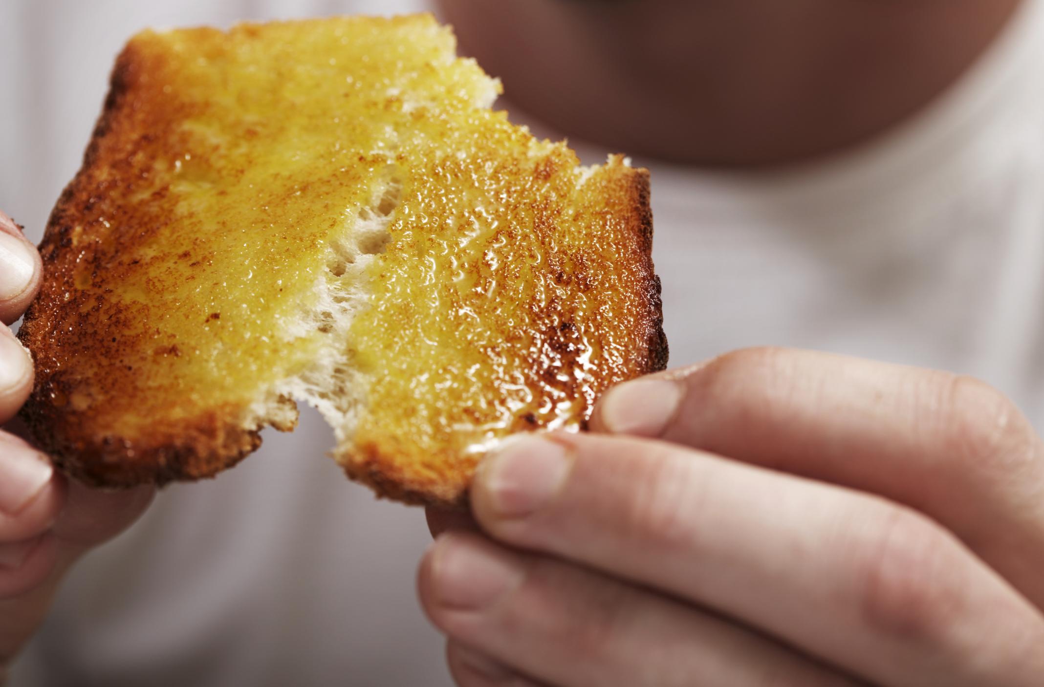 Man breaking bread