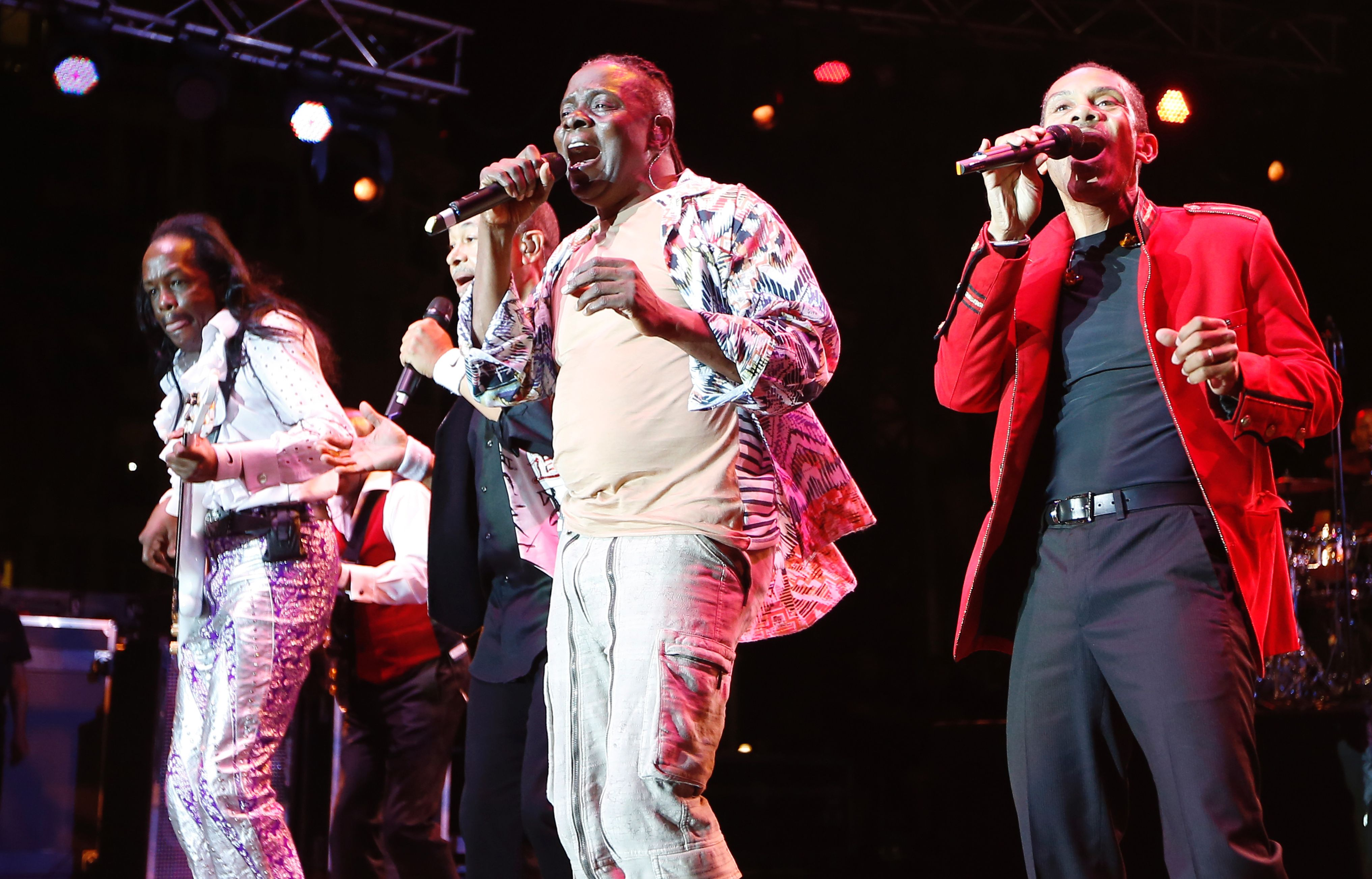 (FILES) This file photo taken on July 08, 2013 shows L-R) Verdine White, Ralph Johnson, Phillip Bailey and B. David Whitworth of Earth, Wind and Fire performing on stage at the Nice Jazz Festival,in Nice, southeastern France. Earth, Wind & Fire founder Maurice White, whose feel-good funk anthems packed arenas, broke down racial barriers and made him among his generation's best-selling artists died on February 4, 2016. He was 74. Brought up in Chicago, White saw himself as an heir to the jazz greats but developed a fresh sound of tight pop tunes that brought in elements of R&B, rock, soul and funk. / AFP / VALERY HACHEVALERY HACHE/AFP/Getty Images