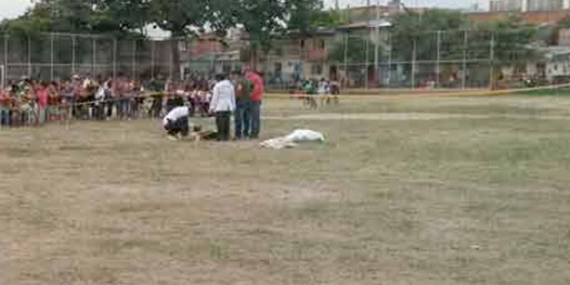 "A soccer match ended in tragedy when a young player shot and killed the referee after he showed him a red card for a foul. The attacker, who is still at large and being hunted by the police, also shot another footballer, aged 25, in the chest but he survived. Police said the man being sought for the fatal shooting had the gun in his backpack and ran on to the pitch as the game was continuing. He shot the referee three times, hitting him in the head, chest and neck. The horrific incident happened in the Córdoba district of Argentina yesterday. Police said the attack happened 20 minutes into the game between two local sides from the neighbourhood. The dead referee has been named as César Flores, who was 48. The other player seriously injured was Walter Zárate who was rushed to hospital but is said to be out of danger. He was struck by a bullet when he got in the way. The attacker was apparently sent off for flooring an opponent during the game ""It all happened during the match,"" said a police spokesman. ""We don't know what happened with the referee but the player was angry and went to get his gun and killed him."" Officers have today been searching the locality for the wanted man but have so far found no trace."