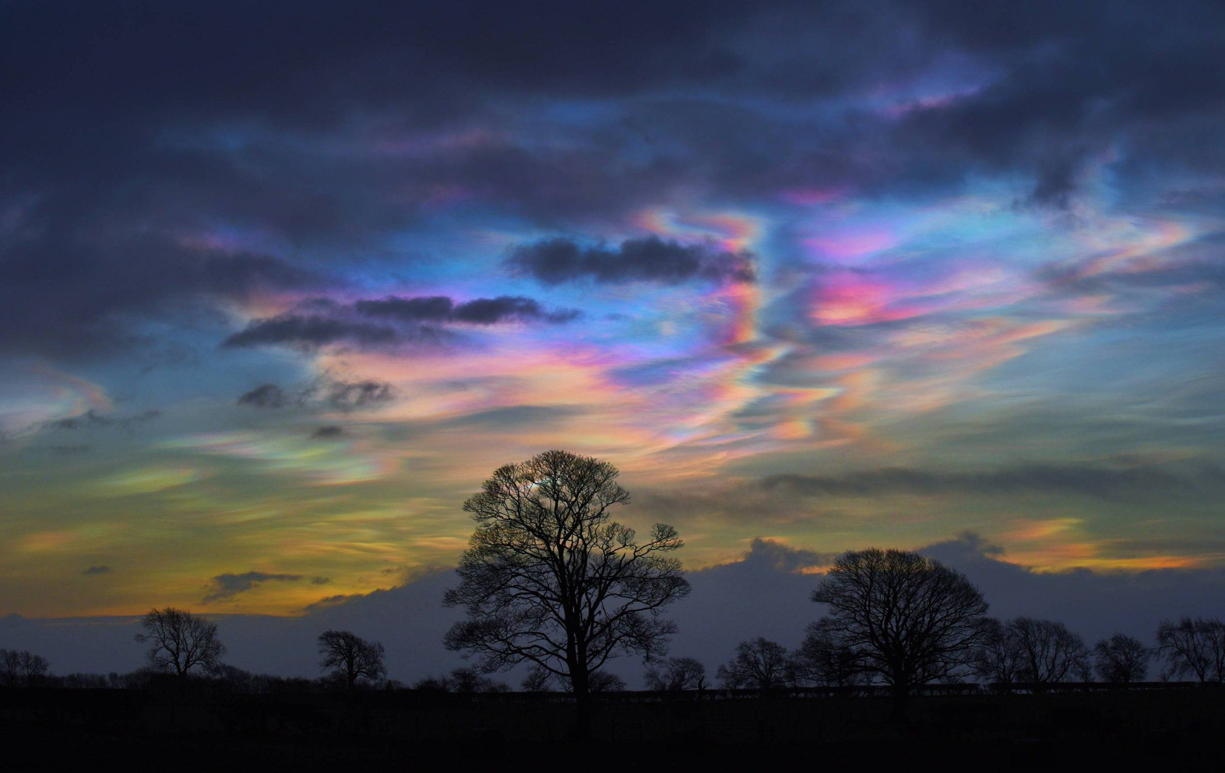 """Dated: 02/02/2016 Storm Henry introduced very rare Nacreous clouds to form over the UK, pictured is the """"Mother of Pearl"""" clouds shining their iridescent colours over Teesdale, County Durham before dawn this morning (Tues). These clouds form in temperatures around -80C and reach heights between 50,000ft to 85,000ft in the stratosphere and more commonly seen in the polar regions"""
