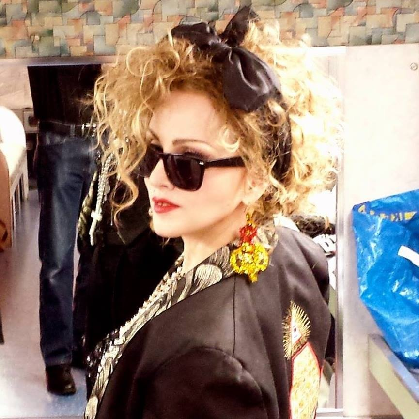 Chris America, 51, a Madonna lookalike from Washington D.C., USA, August 2013. Chris, is such a dead ringer for pop icon Madonna that she can charge anything between USD1,200 and USD35,000 for a single appearance as a Madonna impersonator. She has appeared on magazine covers, television shows, advertisements and corporate events Chris has made a successful career from her uncanny resemblance to the ëVogueí hitmaker since the 80s. However Chris admits that impersonating Madonna for over 33 years is hard work. Chris maintains a strict diet so she can emulate 57-year-old Madgeís muscly physique and even had a celebrity dentist drill a gap between her front teeth. Ö SEE COPY Ö PIC BY NEWS DOG MEDIA Ö Ö +44 (0)121 517 0019