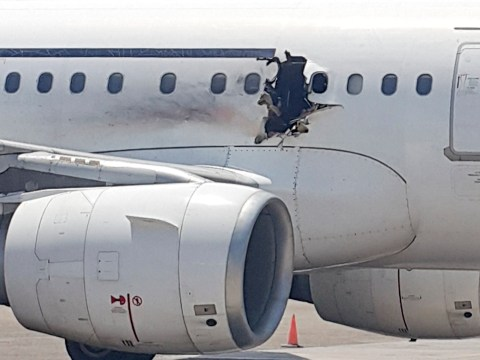 Explosion on Somalian plane 'caused by bomb'
