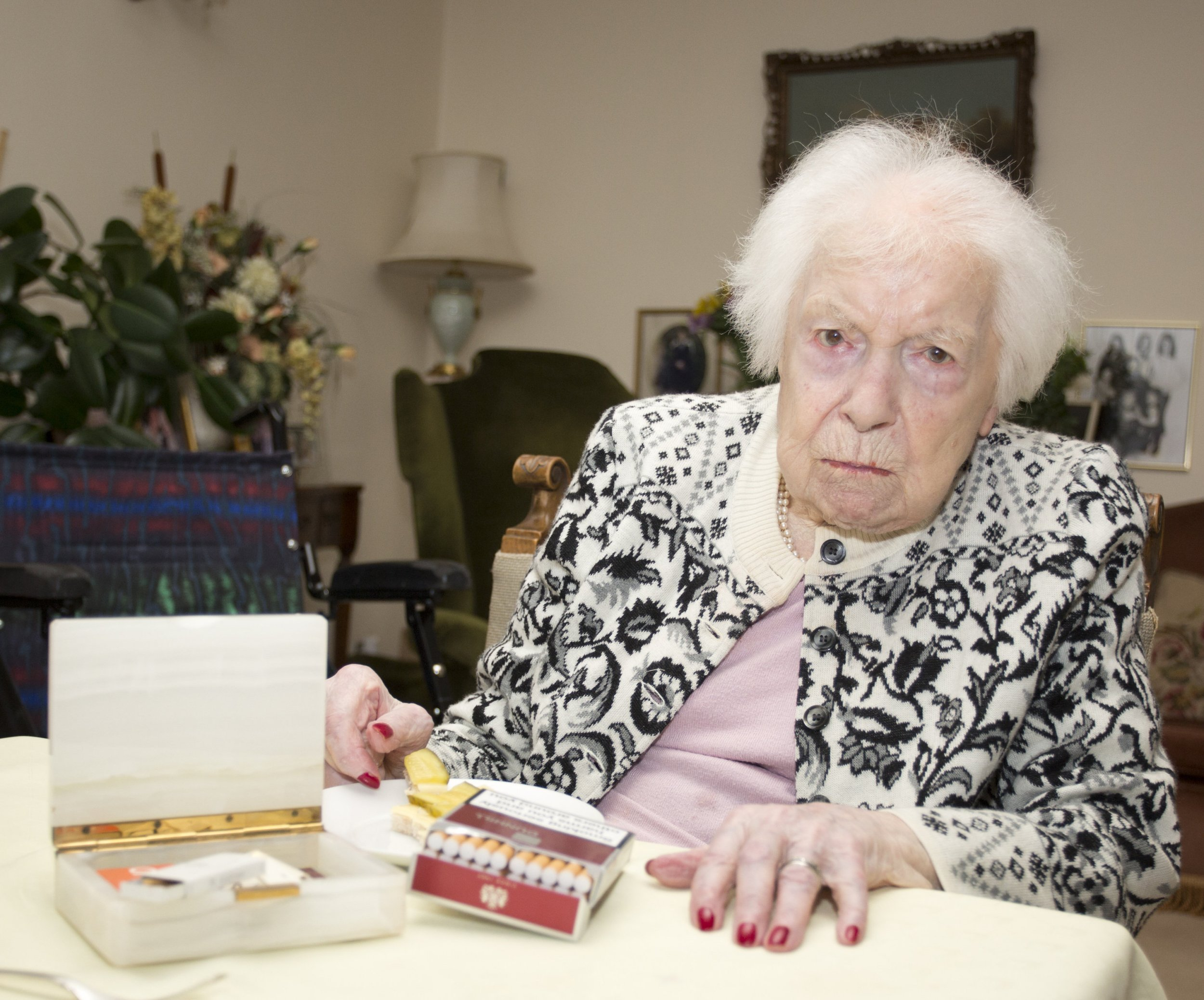 "Great grandmother Muriel Froomberg, 107, likes to enjoy a bottle of whisky once a week mixed with ginger ale at her home in St John's Wood, north London. She stopped smoking at the age of 102 because she wanted to see her great-great grandchildren grow. See SWNS story SWFAGS: A woman who turned 107 says her secret to long life is giving up smoking aged 102 - but still has a secret stash of 800 fags in her room. Muriel Froomberg quit ciggies five years ago so she could ""live a long life"" and watch her great great grandchildren grow up. She packed in the fags at the tender age of 102 - after more than ninety years smoking around 40-a-day - and hasn't looked back. But canny great great granny Muriel has even got 800 cigarettes stashed in her bedroom that she's saving in case she might need them."