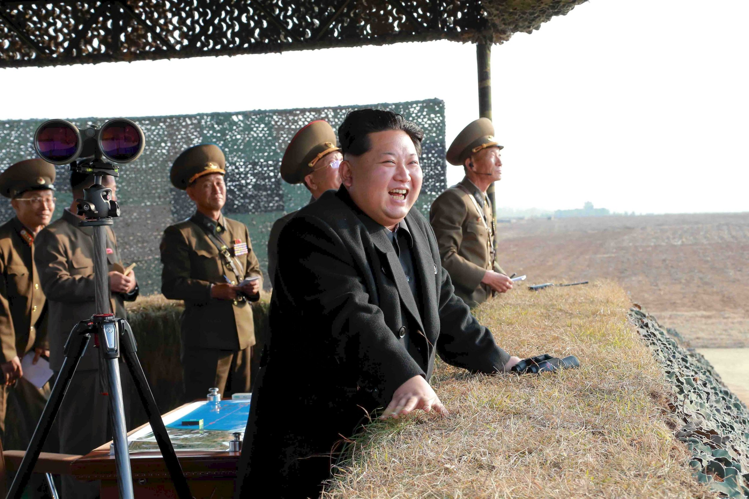 North Korean leader Kim Jong Un watches a rocket firing drill by anti-aircraft units of the Korean People's Army (KPA), in this undated file photo released by North Korea's Korean Central News Agency (KCNA) in Pyongyang November 3, 2015. North Korea has brought forward a time frame for the launch of a rocket that it says will carry an earth observation satellite, to begin on February 7, 2016, the Japanese and South Korean governments said on February 6, 2016. REUTERS/KCNA/Files ATTENTION EDITORS - THIS PICTURE WAS PROVIDED BY A THIRD PARTY. REUTERS IS UNABLE TO INDEPENDENTLY VERIFY THE AUTHENTICITY, CONTENT, LOCATION OR DATE OF THIS IMAGE. FOR EDITORIAL USE ONLY. NOT FOR SALE FOR MARKETING OR ADVERTISING CAMPAIGNS. NO THIRD PARTY SALES. NOT FOR USE BY REUTERS THIRD PARTY DISTRIBUTORS. SOUTH KOREA OUT. NO COMMERCIAL OR EDITORIAL SALES IN SOUTH KOREA. THIS PICTURE IS DISTRIBUTED EXACTLY AS RECEIVED BY REUTERS, AS A SERVICE TO CLIENTS. TPX IMAGES OF THE DAY