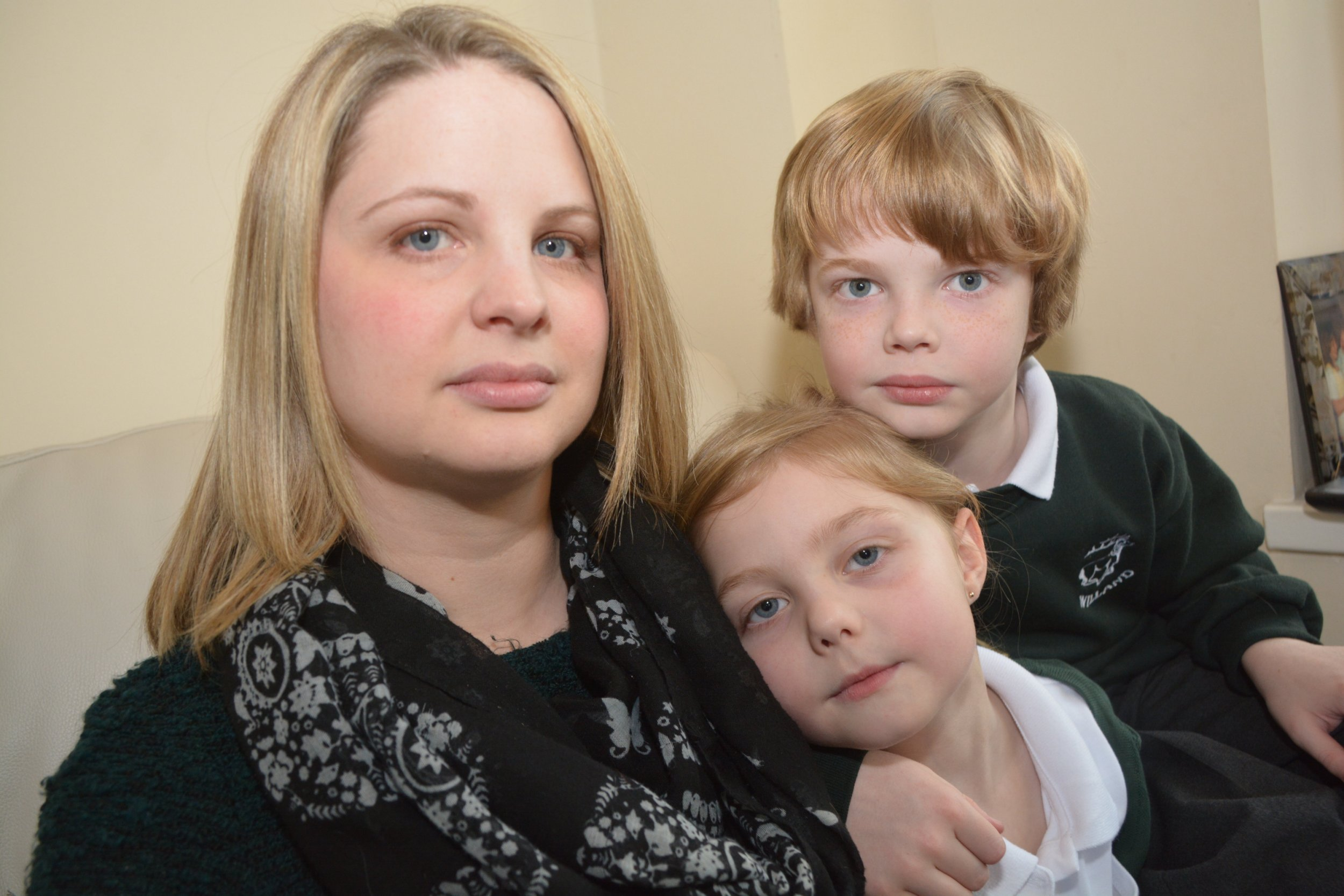 """Zara Heal with her children Cody, eight, and Miley, six. See SWNS story SWCLASS: A mum fined for twice taking her kids out of school has hit out - claiming the trips were MORE educational than a day in the classroom. Furious Zara Heal, 28, has been ordered to pay £120 after taking Cody, eight, and Miley, six, for two short stays in Spain and France during term time. But she has labelled her fine """"ridiculous"""" and argued they learnt more valuable lessons during the four day breaks than they would have if they had been stuck in school. The warehouse operator of Willand, Devon, said pupils are often told it is good for children to experience new cultures and foreign languages - and claims they caught up with all of their school work when they returned."""