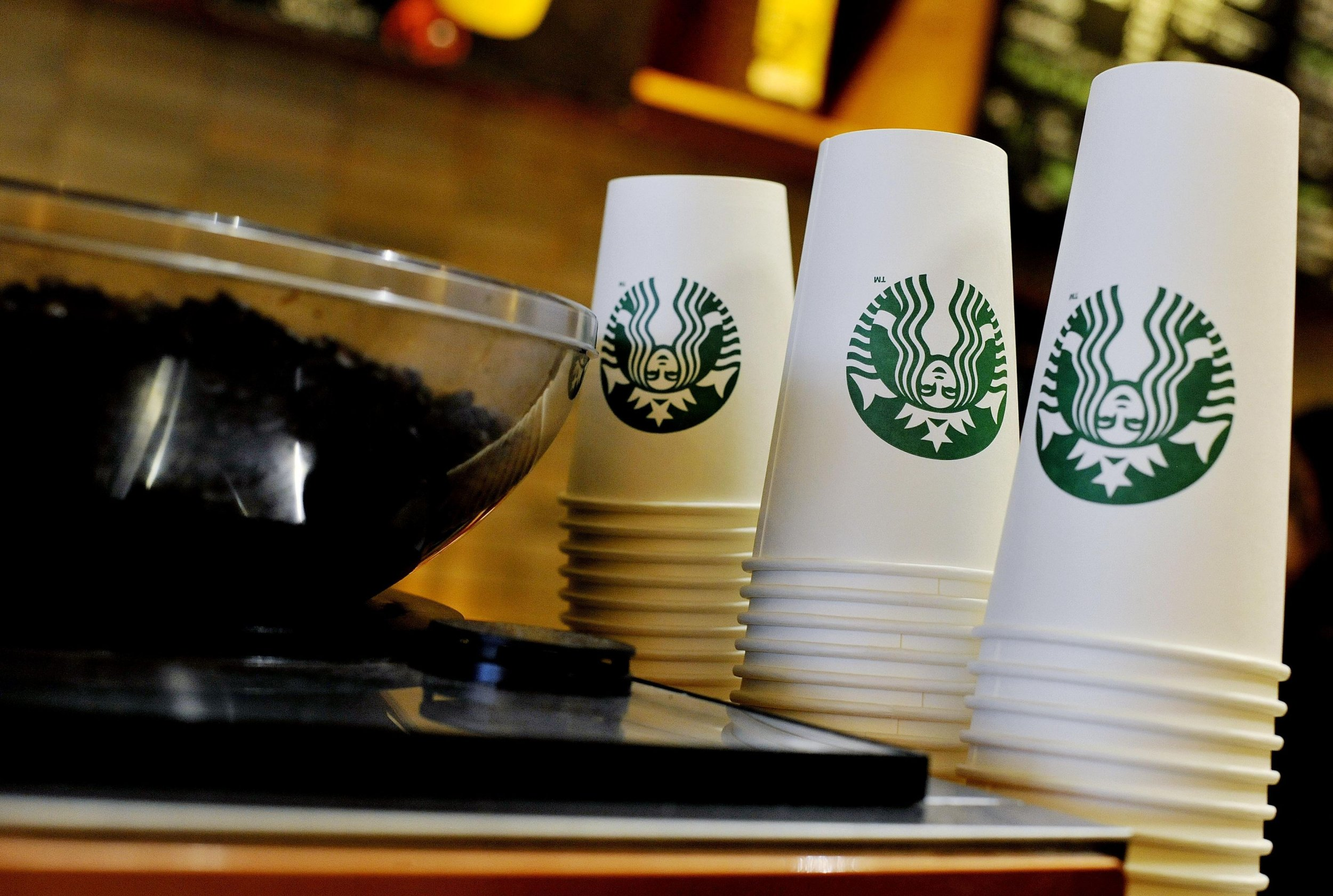 "Embargoed to 0001 Wednesday February 17 File photo 13/8/2013 of Starbucks takeaway cups. There are ""shocking"" amounts of sugar found in a number of hot drinks regularly bought on Britain's high streets, Action on Sugar has said. PRESS ASSOCIATION Photo. Issue date: Wednesday February 17, 2016. The charity performed analysis on 131 hot flavoured drinks and found that 98% of the drinks tested would receive a red nutritional value label for high sugar content. The drink which was found to have the highest sugar content was Starbucks' venti Grape with Chai, Orange and Cinnamon Hot Mulled Fruit, which had a total of 25 teaspoons of sugar per serving, the campaign group said. See PA story HEALTH Sugar. Photo credit should read: Nick Ansell/PA Wire"