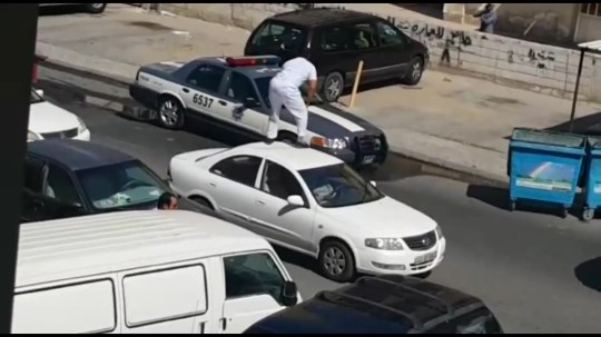 Twerking drunk knocks out police officer with roundhouse kick Credit: YouTube/Media Sharing Video
