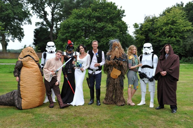 PIC FROM CATERS NEWS - (PICTURED: Guests at the Star Wars wedding included Pauls sons Tom and Matthew as stormtroopers, Davinas daughter Coralie as Darth Vader, Pauls best man tim as Chewbacca, Pauls daughter Hannah as Boba Fett, Davinas Dad Tommy as Obi Wan Kenobi, friends of the family are also pictured as Jabba the Hutt and Luke Skywalker.) - Childhood sweethearts who were separated for three decades have surprised family with a Star Wars themed wedding. Davina Helsop, 49, from Marlow, Buckinghamshire, first dated Paul, 51, when they were in college in 1984 but drifted apart just months later. But fate, or the force, had plans to rekindle their romance, when after 27-years Davina stumbled across a man she believed to be her childhood sweetheart on a dating site.The pair exchanged messages before quickly meeting the same evening to catch up on two decades worth of events. The couple soon fell in love and got engaged, but unlike conventional weddings Davina, who is an avid Sci-Fi fan, decided the couple would theme their big day around her favourite Star Wars films. SEE CATERS COPY.