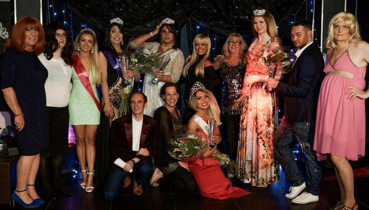 "Jai Dara Latto (red dress front) when she was crowned Miss Transgender UK. See Centre Press story CPTRANS; The Scottish winner of a national transgender beauty pageant has had her title stripped from her as she is ""not transgender enough"". Jai Dara Latto, from Walkerburn in Peeblesshire, was named Miss Transgender UK in a ceremony in London in September last year. But now, Rachael Bailey, who runs the pageant, has removed Jai's title and is set to crown another beauty queen, Daisy Bell, the winner after seeing video footage she claims proves Ms Latto is not living as a woman full time. Jai, however, insists she is transgender and says she has already begun hormone treatment to become biologically female."